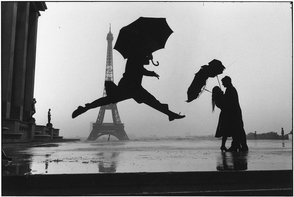 Elliott Erwitt Paris, France 1989 (umbrella jump)