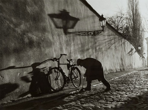 Untitled (Man Repairing Bicycle tire)